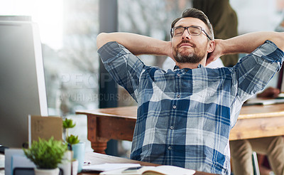Buy stock photo Cropped shot of a mature businessman taking a break at his desk