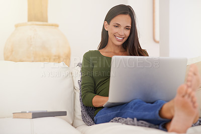 Buy stock photo Shot of a pregnant woman using a laptop at home