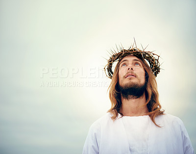 Buy stock photo Shot of Jesus standing in a bare landscape
