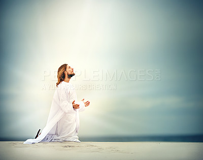 Buy stock photo Shot of Jesus kneeling with his arms outstretched on a bare landscape