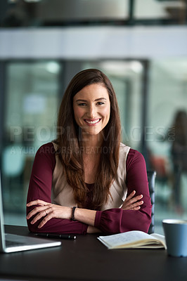 Buy stock photo Shot of a happy businesswoman using wireless technology in her office