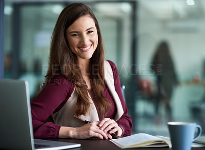 Buy stock photo Shot of a businesswoman sitting at her desk with her laptop