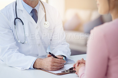 Buy stock photo Cropped shot of a male doctor talking to a patient in his office