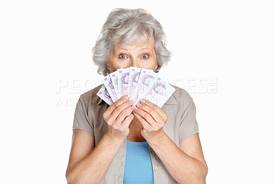 Buy stock photo Portrait of a senior woman holding cash in hands on white background