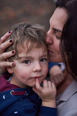 Buy stock photo Cropped shot of a mother embracing her little son