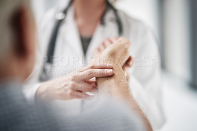 Buy stock photo Closeup shot of a doctor taking the pulse of a senior patient in her office
