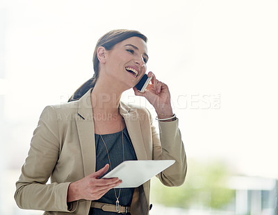 Buy stock photo Shot of a professional businesswoman using a phone and digital tablet at work
