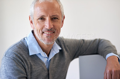 Buy stock photo Portrait of a mature businessman leaning on his computer in the office