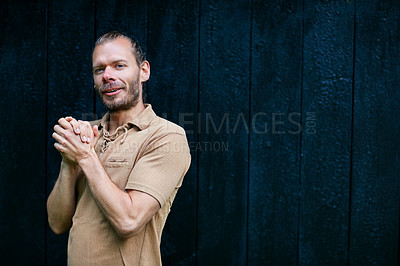 Buy stock photo Portrait of a handsome man standing outdoors