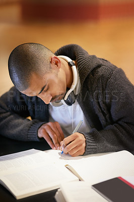 Buy stock photo Cropped shot of a college student working at campus