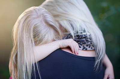Buy stock photo Cropped shot of a mother consoling her little girl