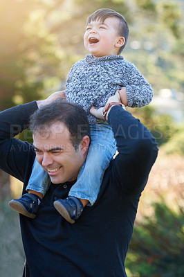 Buy stock photo Cropped shot of a father bonding with his little boy outside