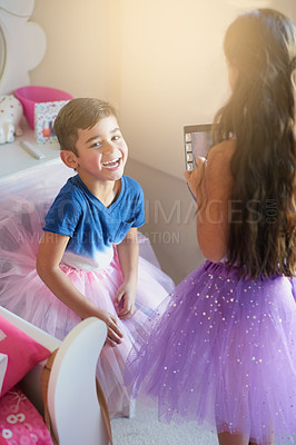 Buy stock photo Shot of a cute little girl playing makeover with her brother at home