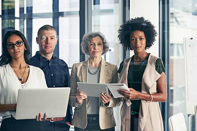 Buy stock photo Portrait of a team of colleagues using modern technology during an informal meeting