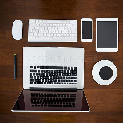 Buy stock photo High angle shot of various digital devices on a table