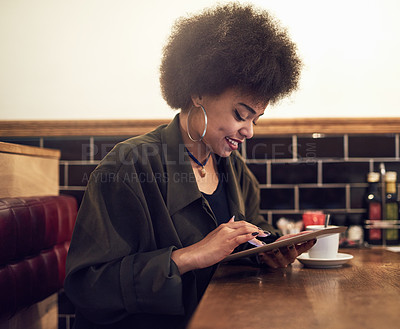Buy stock photo Cropped shot of a beautiful young woman using a digital tablet in a cafe