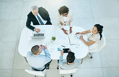 Buy stock photo High angle shot of a group of businesspeople having a meeting