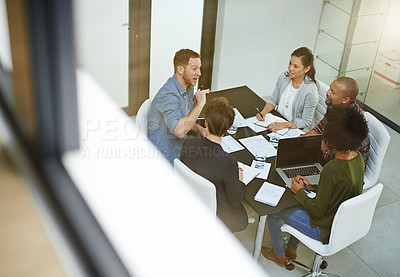 Buy stock photo Shot of a team of colleagues having a meeting in a office