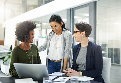 Buy stock photo Shot of a group of businesswomen having a meeting in a office