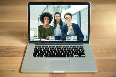 Buy stock photo Shot of a diverse team of colleagues having a video conference on a laptop