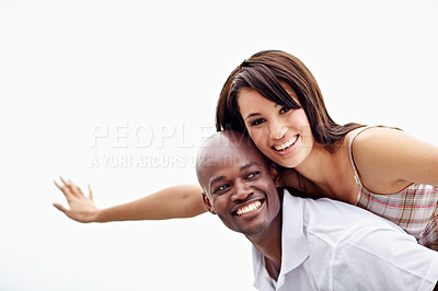 Buy stock photo Portrait of a man carrying his girlfriend on his shoulders while enjoying a day outside together