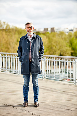 Buy stock photo Portrait of a handsome mature man standing on a bridge