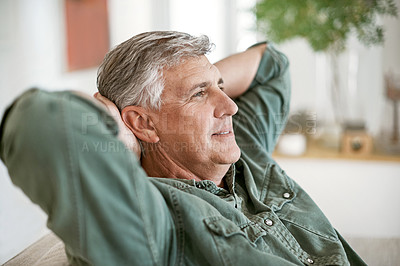 Buy stock photo Cropped shot of a mature man relaxing at home