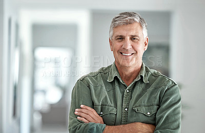 Buy stock photo Portrait of a mature man standing with his arms crossed at home