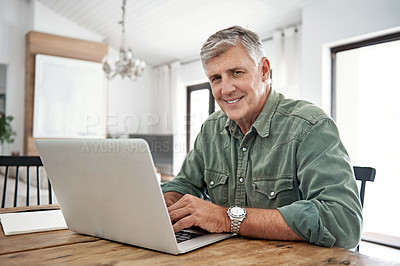 Buy stock photo Portrait of a mature man working on his laptop at home