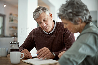 Buy stock photo Shot of a mature couple talking while using a digital tablet