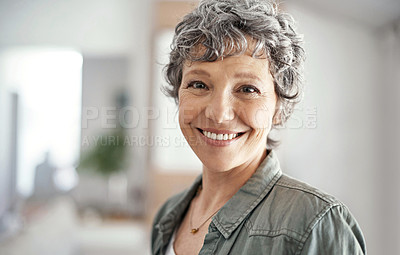Buy stock photo Portrait of a mature woman smiling while standing in her home