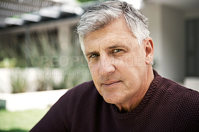 Buy stock photo Cropped shot of a man sitting outside