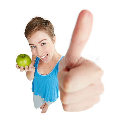 Buy stock photo Shot of a young woman eating an apple against a white background