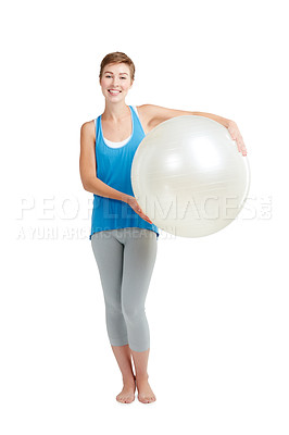 Buy stock photo Studio shot of a young woman holding a fitness ball