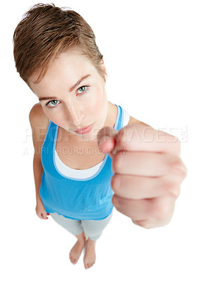 Buy stock photo Shot of a young woman holding up her fist against a white background