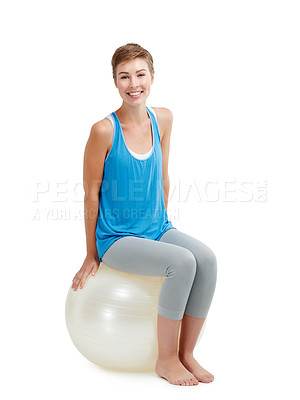Buy stock photo Studio shot of a young woman sitting on a exercise ball