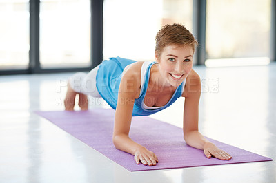 Buy stock photo Shot of a young woman practising yoga at the gym