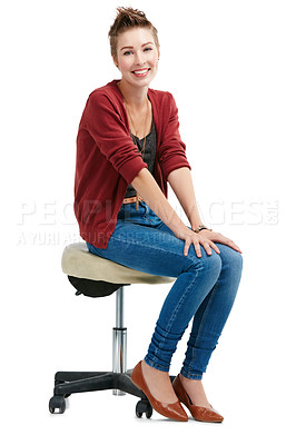 Buy stock photo Studio portrait of a happy young woman sitting on a chair against a white background