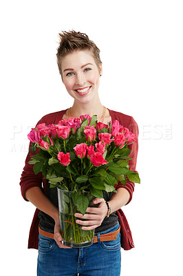 Buy stock photo Studio portrait of a happy young woman holding a bouquet of flowers against a white background