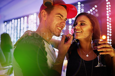 Buy stock photo Shot of a young couple enjoying themselves at a nightclub