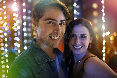 Buy stock photo Portrait of a young couple enjoying themselves at a nightclub