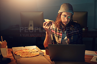 Buy stock photo Cropped shot of a designer working on his laptop on a night shift at work