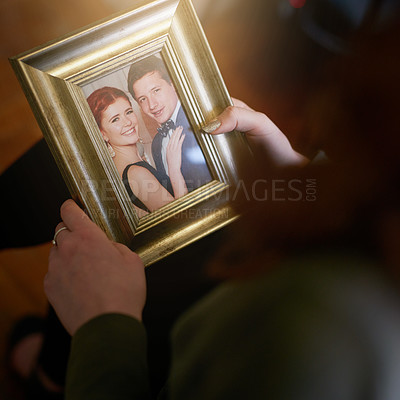 Buy stock photo High angle shot of someone holding a wedding photo