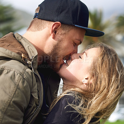 Buy stock photo Shot of an affectionate young couple spending time together outdoors