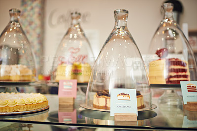 Buy stock photo Shot of cakes displayed on a counter in a cake shop