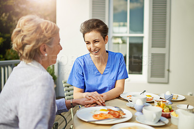 Buy stock photo Shot of a nurse sitting with her senior patient