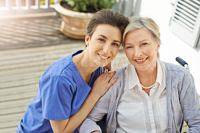 Buy stock photo Shot of a nurse caring for her senior patient in a wheelchair