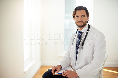Buy stock photo Portrait of a doctor holding a clipboard in a hospital