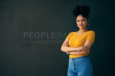 Buy stock photo Shot of a young woman posing against a grey background