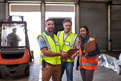 Buy stock photo Portrait of a group of coworkers holding clipboards while standing in a large warehouse